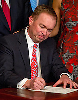 Former United States Representative Mick Mulvaney (Republican of South Carolina) signs the signs the affidavit of appointment after being sworn-in to be Director of the Office of Management and Budget (OMB) by US Vice President Mike Pence in the Vice President's Ceremonial Office at the White House in Washington, DC on Thursday, February 16, 2017.<br /> Credit: Ron Sachs / Pool via CNP /MediaPunch