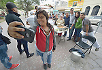 """Carisa Aquilar takes a photo of herself and other Methodists in Nuevo Laredo, Mexico, after they served food to Cuban immigrants in that city's Plaza Benito Juarez on March 3, 2017. Hundreds of Cubans are stuck in the border city, caught in limbo by the elimination in January of the infamous """"wet foot, dry foot"""" policy of the United States. They are not allowed to enter the U.S. yet don't want to return to Cuba. Many of the city's churches have become temporary shelters for the immigrants, and congregations rotate responsibility for feeding the Cubans, who have slowly been forced to appreciate Mexican cuisine. Such solidarity from ordinary Mexicans is being tested these days, as not only are the Cubans stuck at the border, but the U.S. has stepped up deportations of Mexican nationals, while at the same time detaining many undocumented workers from other nations and simply dumping them on the US-Mexico border. Aguilar is a member of the Aposento Alto Methodist Church in Nuevo Laredo."""