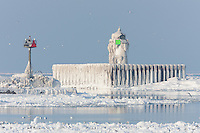 The Cleveland Harbor East Pierhead Light covered by frozen layers of ice.  The lighthouse was encased in ice by crashing waves in frigid air temperatures during mid-December.
