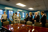 South Korean Chief of Defense Kim Tae-young, far left, South Korean Foreign Minister Yu Myung-hwan, center, United States Secretary of Defense Robert M. Gates, second right, and U.S. Secretary of State Hillary Rodham Clinton tour the T2 building as a North Korean Soldier looks through the window during a tour of the Demilitarized Zone (DMZ) in Korea, Wednesday, July 21, 2010.  .Mandatory Credit: Cherie Cullen - DoD via CNP