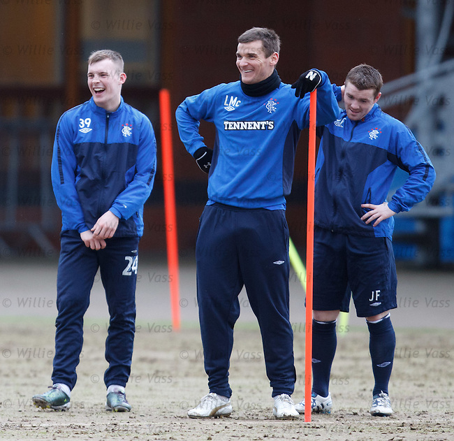 Lee McCulloch leaning on a pole and having a chuckle