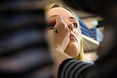 Russian model Natasha (Natalia) Buzaeva has her face made-up before a photo shoot in Moscow. Buzaeva, born in 1985, represented by the agency Point, is also a student at a university in Moscow. .Russia supplies many models to the West. ..Photograph by Justin Jin