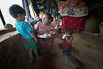 Sarita Majhi eats with her children, 4-year old Sanir and 1-year old Sanira, in their temporary shelter in Adamtar, a village in the Dhading District of Nepal. Dan Church Aid, a member of the ACT Alliance, has provided food, shelter, livelihood, winterization assistance and a variety of other support to Majhi and other indigenous villagers here in the wake of a devastating 2015 earthquake. Majhi has had to face the earthquake and its aftermath alone, as her husband is working in Saudi Arabia. He stopped sending money home and told Majhi to quit calling him.