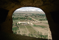 A view from the head of the 34 meters high Bamiyan Buddha and is top fresco, in 1995..The Bamiyan bazaar, the airport, the Kakrak Valley and the Baba range mountain's at 4743 meters high.