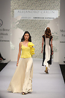 A model walks with a dress displays a creation by Mexican designer Alejandro Carlin During The Mercedes Benz Fashion Week Mexico Spring/Summer 2015, in Mexico City, 10.01.2014. VIEWpress / Miguel Angel Pantaleon
