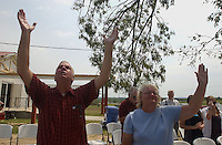 Rainsville, Alabama: Coy and Ellen Baldwin offer prayers during a service at Brown's Chapel Baptist Church the first Sunday after tornados ripped through this rural northeastern Alabama town. Rainsville and surrounding DeKalb County counted at least 33 people killed in the tornados. (PHOTO: MIGUEL JUAREZ LUGO)