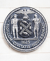 The seal of the City of New York on the side of a school in New York on Saturday, April 15, 2017. (© Richard B. Levine)