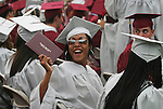 NAUGATUCK, CT - 20 June 2004 - 062204BZ12- Raquel Pinckney holds her diploma up to show family and friends during commencement excercises at Naugatuck High School Tuesday night.<br />