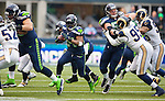 Seattle Seahawks running back Marshawn Lynch (24) runs against the St. Louis Rams in the third quarter at CenturyLink Field in Seattle, Washington on December 29, 2013.  Seahawks clinched the NFC West title and home-field advantage throughout the playoffs with a 27-9 victory over the St. Louis Rams.  Lynch rushed for 97yards on 23 carries and scored one touchdown in the win.  ©2013. Jim Bryant Photo. ALL RIGHTS RESERVED.