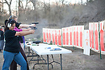 Viki Villareal, left foreground, shoots a target during a concealed handgun training class offered to teachers and staff of Clifton Independent School District in Clifton, Texas. Ms. Villareal teaches Spanish at Clifton High School. February 7, 2013. CREDIT: Lance Rosenfield/Prime