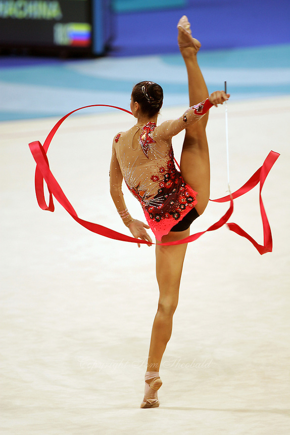 Irina Tchachina of Russia turns pirouette with ribbon at 2004 Athens Olympic Games during qualifying round on August 27, 2006 at Athens, Greece. Irina won silver in the All-Around final. (Photo by Tom Theobald)