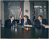 United States President John F. Kennedy meets  the Shah of Iran, Mohammad Reza Shah Pahlavi, in the Cabinet Room at the White House on April 13, 1962.  Left to right:  Shah Pahlavi, President Kennedy, U.S. Secretary of Defense Robert McNamara..Credit: Robert Knudsen - The White House via CNP