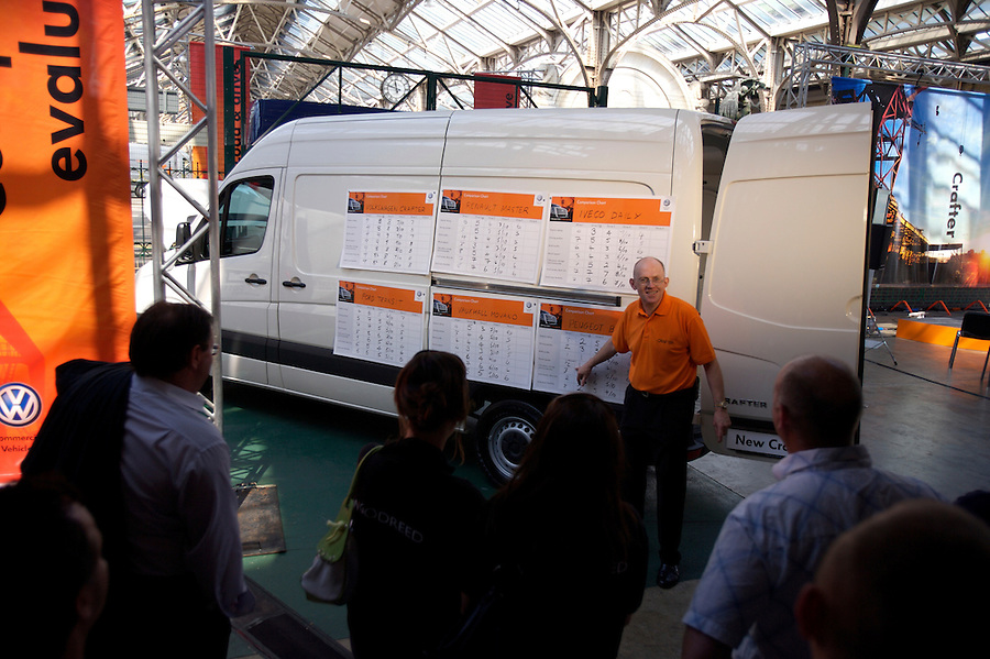 Photo: © Martin Beddall 5-7-06.VW Crafter van presentation day at Dover. Introducing the new van to Uk dealers and their customers as part of a roadshow around the UK..A presentation evaluating the Crafter against it's competitors. Dealers were  put into groups and asked to mark out of ten the different features of each van model.