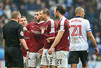 Northampton Town players surround referee Richard Clark after he awarded Bolton Wanderers a penalty<br /> <br /> Photographer Alex Dodd/CameraSport<br /> <br /> The EFL Sky Bet League One - Bolton Wanderers v Northampton Town - Saturday 18th March 2017 - Macron Stadium - Bolton<br /> <br /> World Copyright &copy; 2017 CameraSport. All rights reserved. 43 Linden Ave. Countesthorpe. Leicester. England. LE8 5PG - Tel: +44 (0) 116 277 4147 - admin@camerasport.com - www.camerasport.com