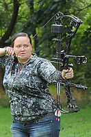 NWA Democrat-Gazette/FLIP PUTTHOFF<br /> Hannah Cicioni logs hours of practice      August 6 2015     with her bow to prepare for her western elk hunting adventures.
