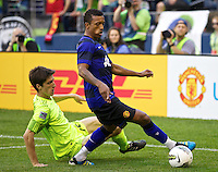 Manchester United midfielder Nani gets control of the ball from Seattle Sounders FC midfielder Alvaro Fernandez during play at CenturyLink Field in Seattle Wednesday July 20, 2011. Manchester United won the match 7-0.
