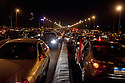 Traffic is brought to a standstill on the 6th of October bridge in downtown Cairo by Egyptians celebrating the news that Egyptian President Hosni Mubarak had stepped down February 11, 2011 following momentous marches on the public buildings across Cairo, Egypt. (Photo by Scott Nelson)