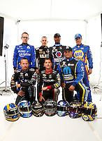 Jan 15, 2015; Jupiter, FL, USA; NHRA Don Schumacher Racing drivers (Front row l-r) Jack Beckman , Spencer Massey , Matt Hagan (Back row l-r) Tony Schumacher , Tommy Johnson Jr , Antron Brown and Ron Capps pose for a portrait during preseason testing at Palm Beach International Raceway. Mandatory Credit: Mark J. Rebilas-USA TODAY Sports