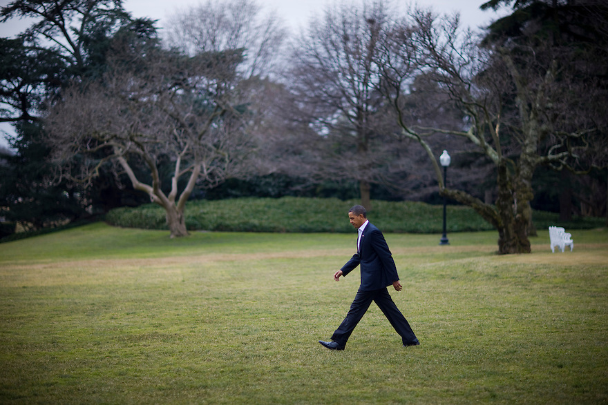 U.S. President Barack Obama walks out of the Oval Office of the White House to Marine One in Washington,