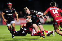 Nick Tompkins of Saracens takes on the Scarlets defence. European Rugby Champions Cup match, between Saracens and the Scarlets on October 22, 2016 at Allianz Park in London, England. Photo by: Patrick Khachfe / JMP