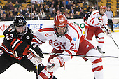 Colton Saucerman (NU - 23), Sean Escobedo (BU - 21) - The Northeastern University Huskies defeated the Boston University Terriers 3-2 in the opening round of the 2013 Beanpot tournament on Monday, February 4, 2013, at TD Garden in Boston, Massachusetts.