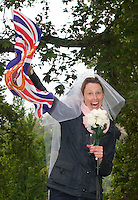 Wendy Campbell from Glasgow  holds her flag as she looks for Princess Kate and Prince William as they Royal party come down the mall in London. .Picture: Maurice McDonald/Universal News And Sport (Europe).29 April 2011..