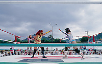 Luchadoras face one another in their threatening poses at the beginning of a match.  Ecatepec, Estado de Mexico. June 2004