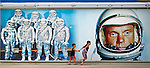 Aidan Schultz, 4, and sister Rylee Schultz, 7, of Melbourne Kentucky, run past a mural of John Glenn and fellow astronauts at the Kennedy Space Center Visitor Complex on June 29, 2011. When the Space Shuttle shuts down, so will much of the Space Coast's economy. But launches will continue-- increasingly, for profit.