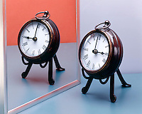 CLOCK REFLECTED IN PLANE MIRROR<br />