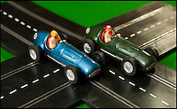 BNPS.co.uk (01202 558833)<br /> Pic: PhilYeomans/BNPS<br /> <br /> Blue Maserati and green Ferrari for the original Scalextric.<br /> <br /> Blast from the past - 56 year old box of the very first Scalextric finally handed over to inventors daughters.<br /> <br /> The dying wish of Scalextric inventor Freddie Francis has been granted - after his daughters were gifted an original mint set that has been in storage for the past 50 years.<br /> <br /> Freddie and his widow Diane boxed up the original set shortly before he died in 1998 and Diana has waited till now before handing the valuable heirloom over.<br /> <br /> The previously unopened set has been preserved in a wooden box at the Francis family home until now.<br /> <br /> The historic set contains 1950's Ferrari and Maserati style racing car's that would have been driven by Fangio and Stirling Moss and even includes oil to keep the cars running and silicone for 'skid patches'.<br /> <br /> Although the set cost &pound;5 in 1957, it's worth well over &pound;1500 today.