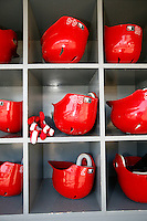 15 June 2011: Reds equipment player batting helmets in the dugout before a Major League Baseball game LA Dodgers vs the Cincinnati  Reds at Dodger Stadium during a day game. #28 Chris Heisey glove.  **Editorial Use Only**