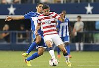 Alejandro Bedoya #20 of the USMNT battles with Jorge Carlos #20 of Honduars on July 24, 2013 at Dallas Cowboys Stadium in Arlington, TX. USMNT won 3-1.