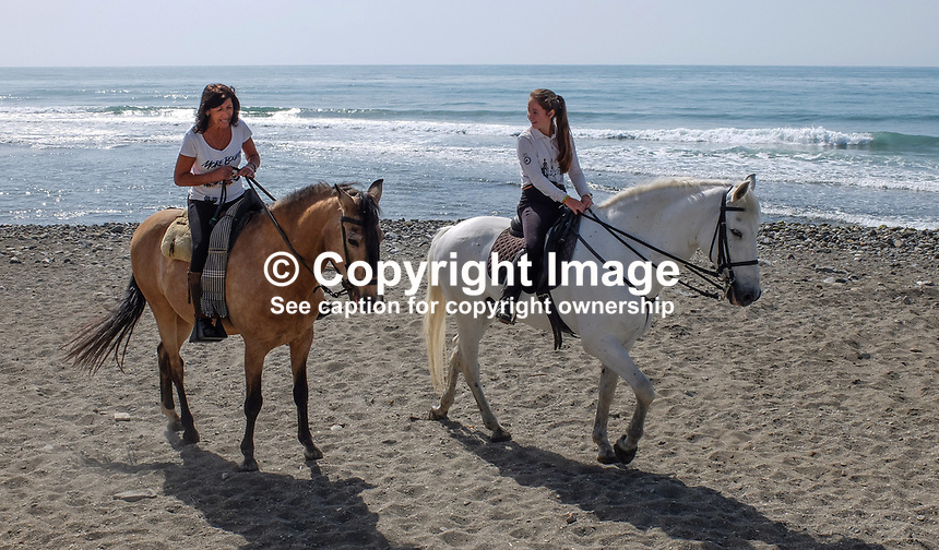 It is nice to be beside the seaside especially when it is beside a warm, sunny Mediterranean - two riders have a canter along the shore near Puerto Banus, 201704233486<br /><br />Copyright Image from Victor Patterson, 54 Dorchester Park, <br />Belfast, UK, BT9 6RJ<br /><br />t1: +44 28 9066 1296 (from Rep of Ireland 048 9066 1296)<br />t2: +44 28 9002 2446 (from Rep of Ireland 048 9002 2446)<br />m: +44 7802 353836<br /><br />e1: victorpatterson@me.com<br />e2: victorpatterson@gmail.com<br /><br />www.victorpatterson.com<br /><br />Please see my Terms and Conditions of Use at www.victorpatterson.com. It is IMPORTANT that you familiarise yourself with them.<br /><br />Images used on the Internet must be visibly watermarked i.e. &copy; Victor Patterson within the body of the image and copyright metadata must not be deleted. Images used on the Internet have a size restriction of 4kbs and will be chargeable at current NUJ rates unless agreed otherwise.<br /><br />This image is only available for the use of the download recipient i.e. television station, newspaper, magazine, book publisher, etc, and must not be passed on to any third party. It is also downloaded on condition that each and every usage is notified within 7 days to victorpatterson@me.com<br /><br />The right of Victor Patterson to be identified as the author is asserted in accordance with The Copyright Designs And Patents Act (1988).