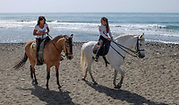 It is nice to be beside the seaside especially when it is beside a warm, sunny Mediterranean - two riders have a canter along the shore near Puerto Banus, 201704233486<br />