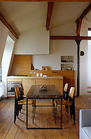 To maximise space the small kitchen is tucked away at one end of the open-plan living/dining room