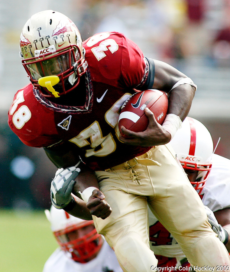 TALLAHASSEE, FL 10/31/09-FSU-NCST FB09 CH28-Florida State's Jermaine Thomas can't elude N.C. State's Dwayne Maddox during first half action Saturday at Doak Campbell Stadium in Tallahassee. .COLIN HACKLEY PHOTO