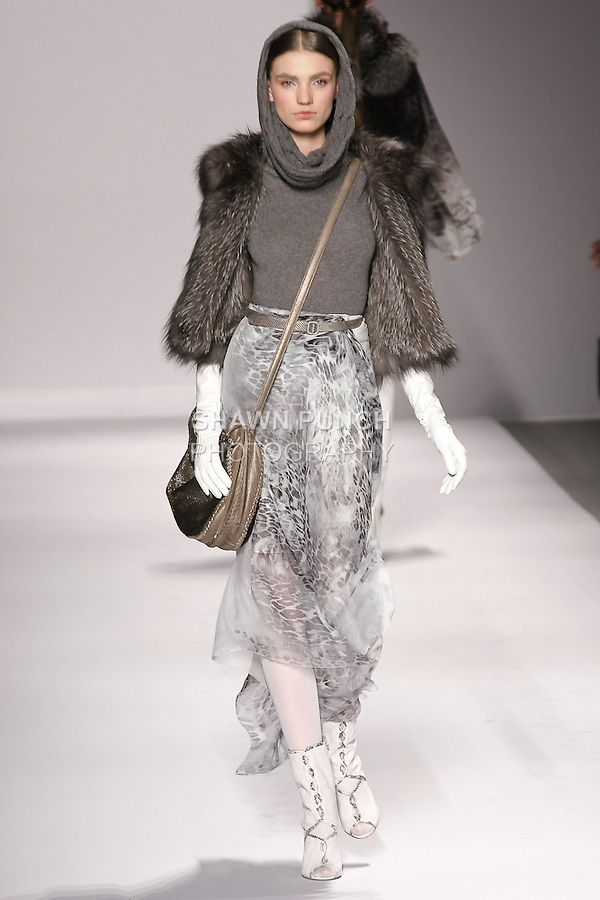 Daniela Mirzac walks runway in an outfit from the Elie Tahari Fall 2011 collection, during Mercedes-Benz Fashion Week Fall 2011.