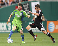 Stephen King #20 of D.C. United moves into Pat Noonan #25 of Seattle Sounders FC during an MLS match at RFK Stadium on July 15 2010, in Washington DC.Seattle won 1-0.