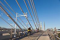 Bicyclists, pedestrians and public transit on the Tilikum Crossing Bridge in Portland, Oregon