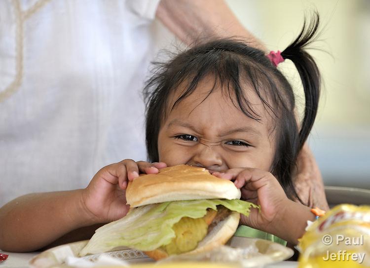girl enjoys her meal at the Good Neighbor Settlement House in ...