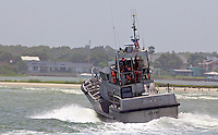 A Coast Guard boat performs manuevers in heavy surf generated by Hurricane Irene, Ponce Inlet, FL, Thursday, August 25, 2011.   (Photo by Brian Cleary/www.bcpix.com)