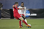 12 December 2008: Ale Ivo (22) of St. John's tries to kick the ball past Rodney Wallace (22) of Maryland.  The University of Maryland Terrapins defeated the St. John's University Red Storm 1-0 during the second sudden death overtime at Pizza Hut Park in Frisco, TX in an NCAA Division I Men's College Cup semifinal game.