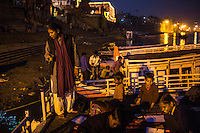 Santwana Manju (left) drinks hot tea as she gives an art class on the roof of the Boat School she runs on the holy Ganges River, in Varanasi, Uttar Pradesh, India on 19 November 2013. The school, accommodating almost 50 children, aims to take the boatmen's children away from working in the tourist areas where they are exposed to trafficking and sexual abuse.