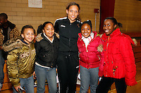 Lolo Jones  poses with some young fans after speaking to the kids at the Tobin Community Center for the Win With Integrity Program on Friday, February 22, 2008. Photo by Errol Anderson,The Sporting Image.