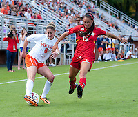 Morgan Brian (6) of Virginia keeps the ball away from Erika Nelson (15) of Maryland during the game at Klockner Stadium in Charlottesville, VA.  Virginia defeated Maryland, 1-0.