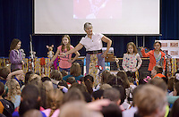 NWA Democrat-Gazette/BEN GOFF @NWABENGOFF<br /> Nellie Beggs of Sydney, Australia teaches Sierra Gussman (from left), Sophia Defreitas, Elizabeth Livingston and Elliot Halford an Aboriginal dance for girls Monday, Feb. 13, 2017, during a presentation at R.E. Baker Elementary in Bentonville. Husband and wife Martin and Nellie Beggs have been presenting their 'Australian Kaleidoscope' program at schools in the United States for over ten years for the Kansas City, Mo. company 'The Cultural Kaleidoscope'. Students joined in songs and Aboriginal dances as they learned about the natural and cultural history of 'The Land Down Under' in assemblies and classes throughout the day.
