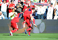 Chicago's Patrick Nyarko (14) and Chris Rolfe (18, center) celebrate with Gonzalo Segares after Segares scored to put Chicago ahead 2-1.  The Chicago Fire defeated the New York Red Bulls 3-1 at Toyota Park in Bridgeview, IL on June 17, 2012.