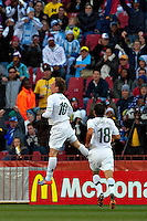 Valter Birsa of Slovenia (left) celebrates scoring the opening goal against USA
