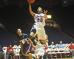 "Ole Miss' Kayla Melson (20) shoots as Arizona's Shanita Arnold (5) defends at the C.M. ""Tad"" Smith Coliseum in Oxford, Miss. on Thursday, November 18, 2010. Arizona won 72-70."