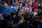 New York, New York<br /> October 9, 2011<br /> <br /> &quot;Occupy Wall Street&quot; protesters encampment at Zuccotti Park overflows on to adjacent streets as more and more people come to take part and view the site.<br /> <br /> The participants of the event, that began on September 17, are mainly protesting against social and economic inequality, corporate greed, and the influence of corporate money and lobbyists on government, among other concerns.